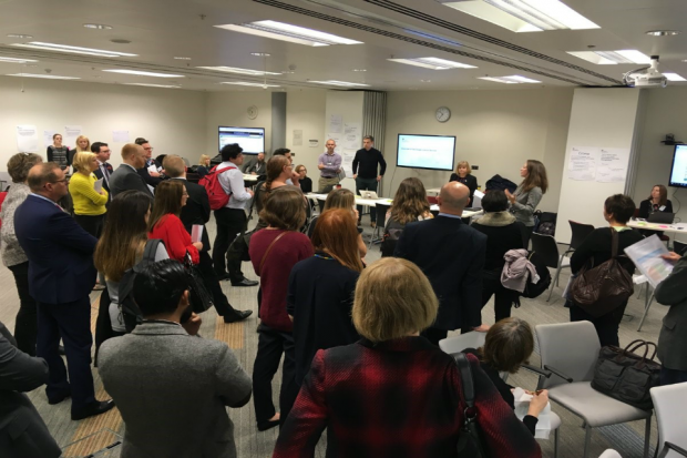 People standing in a room at the public user event in Nov 2018.
