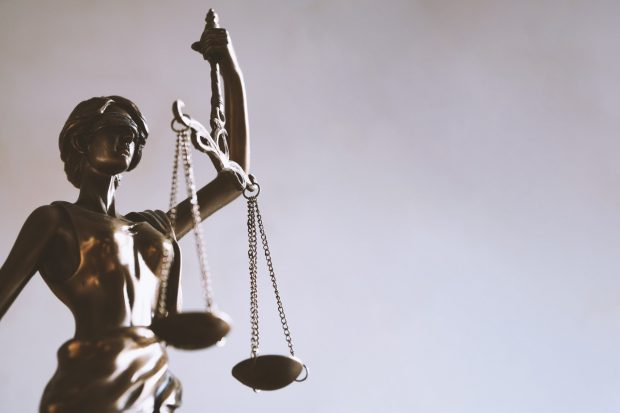 photograph of woan statue holding scales of justice
